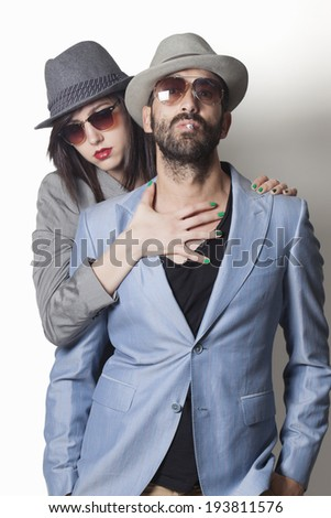 Beautiful gangster couple looking and smoking - stock photo