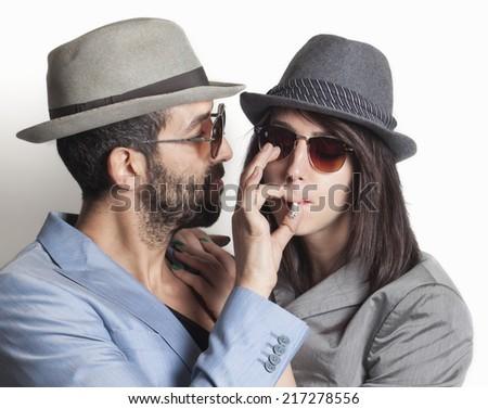 Beautiful gangster couple smoking - stock photo