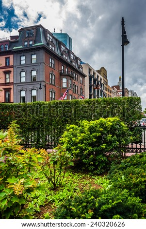 Beautiful garden and buildings in Boston, Massachusetts. - stock photo