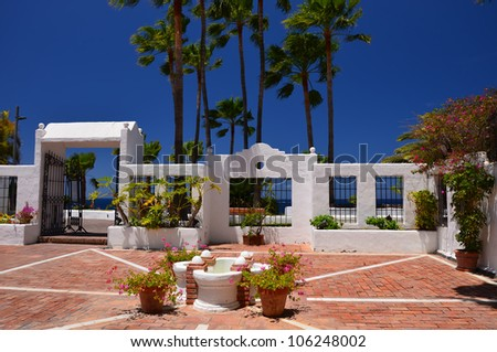 Beautiful garden with palm trees and white buildings, Tenerife, Canary islands, Spain