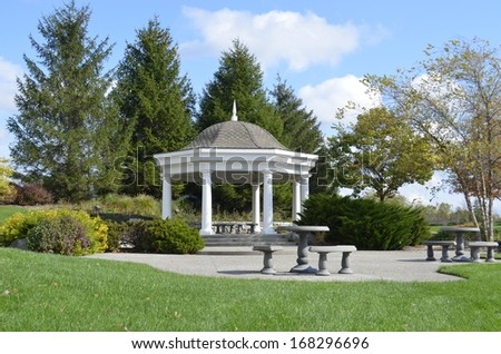 Beautiful gazebo in a park for weddings and parties - stock photo