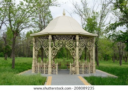 Beautiful Gazebo In A Park Surrounded By Trees And Grass