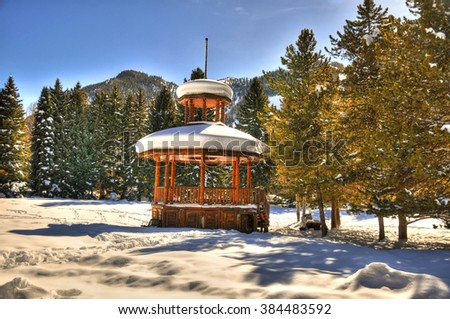 Beautiful gazebo partially covered with snow in Aspen, Colorado on a clear day - stock photo