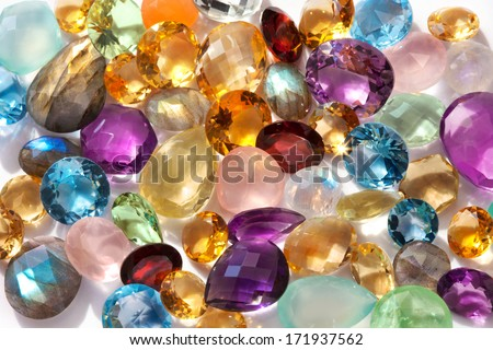 Beautiful gems background. Photo of a sparkling and colorful real gemstones in natural sunlight. - stock photo