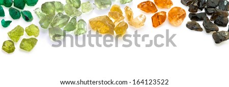 Beautiful gemstones banner. Colorful gems on the white background. - stock photo