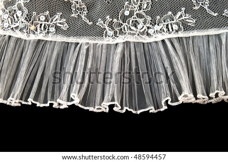 Beautiful gentle lace on a black background - stock photo
