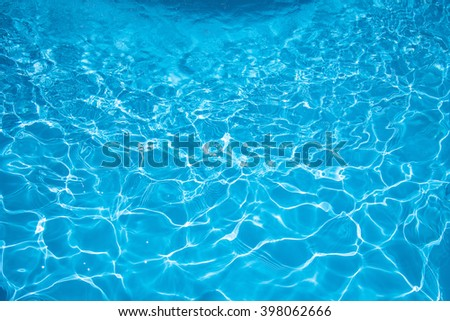 Beautiful Gentle wave in swimming pool with sun reflection - stock photo