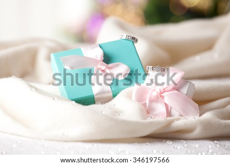 Beautiful gift box and diamond rings. Concept of wedding, marriage, wealth and luxurious lifestyle. (soft focus) - stock photo