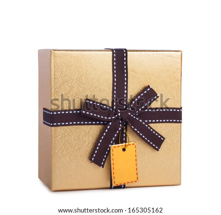 Beautiful gift box in gold paper with bow and label isolated on a white background - stock photo