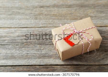 Beautiful gift box on grey wooden background - stock photo