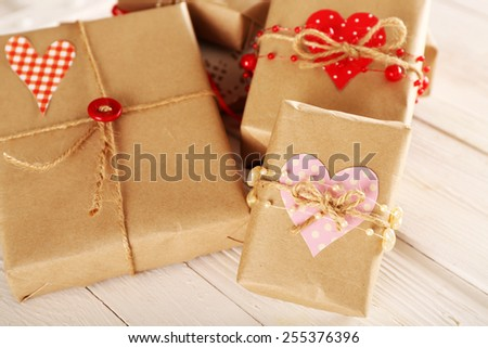 Beautiful gift boxes on wooden background. Valentine Day concept - stock photo