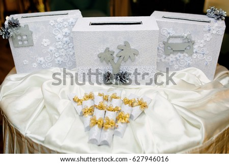 Beautiful Gifts For Guests At A Wedding On The Table