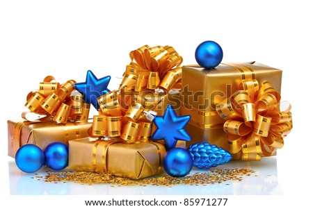 Beautiful gifts in gold packaging and Christmas balls isolated on white - stock photo