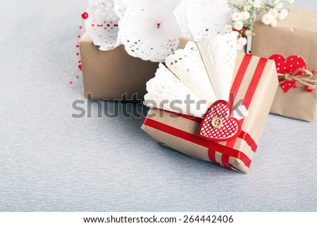 Beautiful gifts on grey background. Valentine Day concept - stock photo