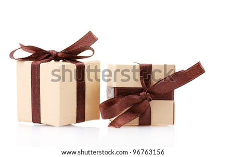 beautiful gifts with bows isolated on white - stock photo