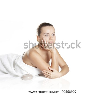 beautiful girl about aroma by candles - stock photo