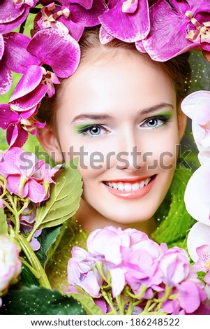 Beautiful girl among the flowers. Spring. - stock photo