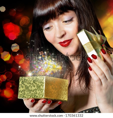 Beautiful Girl and gift in a small box golden.Holiday - stock photo
