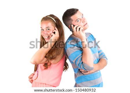 Beautiful girl and handsome boy calling back to back - stock photo
