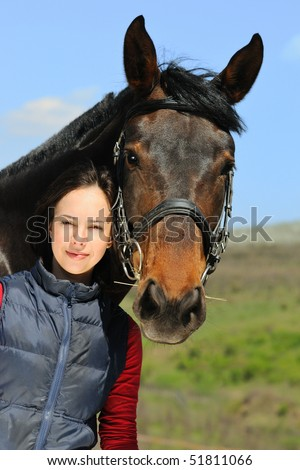 Beautiful girl and her horse - stock photo