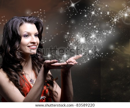 Beautiful Girl and her Magic - stock photo