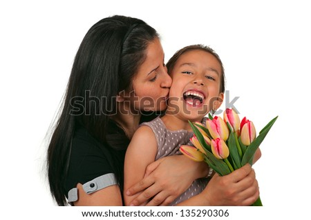 Beautiful girl and her mother celebrating mothers day - stock photo