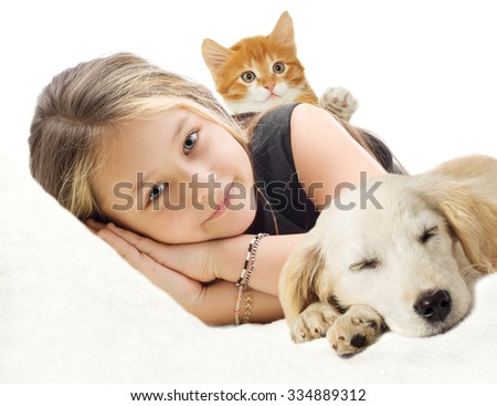 beautiful girl and kitten and Puppy lying on the sofa - stock photo