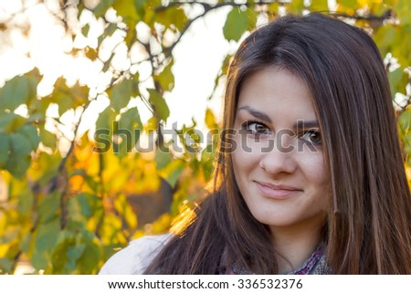 beautiful girl at sunset in autumn forest