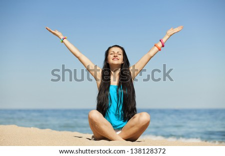 Beautiful girl at the beach. - stock photo