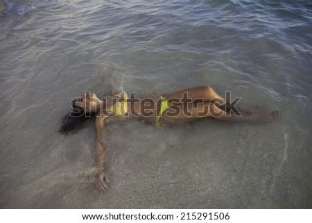 beautiful girl at the beach at sunrise in hawaii - stock photo
