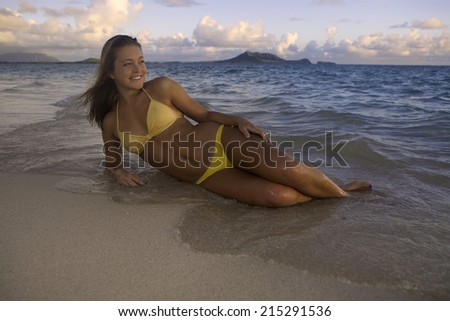 beautiful girl at the beach at sunrise in hawaii - stock photo