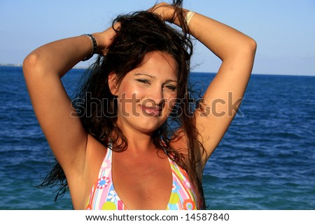 Beautiful girl at the beach on a sunny day