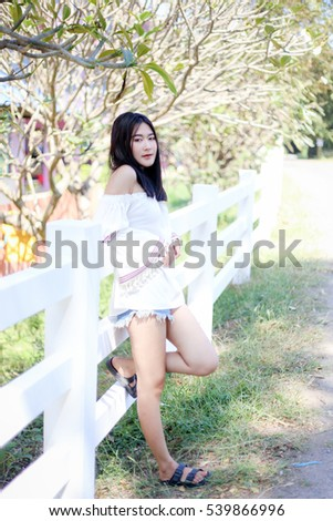 Beautiful girl at the park with perfect smile