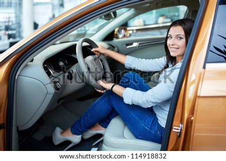 Beautiful girl at the wheel a car - stock photo