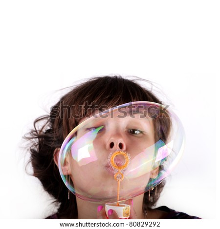 Beautiful Girl Blowing Bubbles (isolated) - stock photo