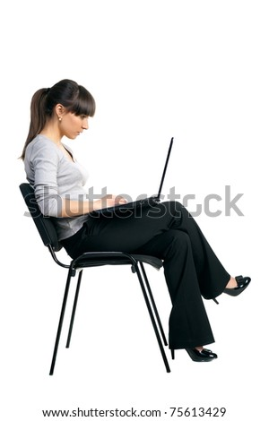 Beautiful girl brunette works at laptop, studio, white background, is insulated - stock photo