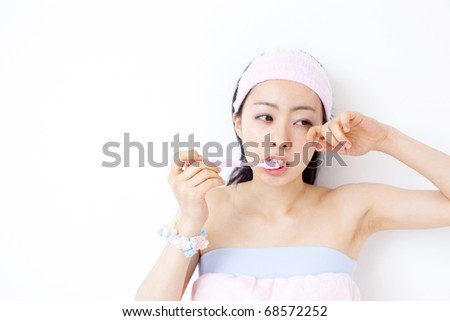 beautiful girl brushing teeth - stock photo