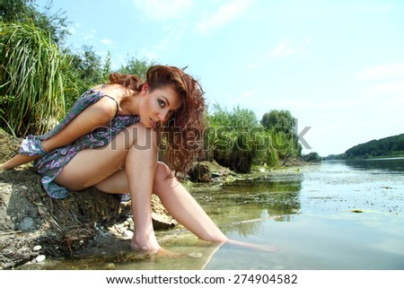 beautiful girl by the lake. good shape, bright emotions.