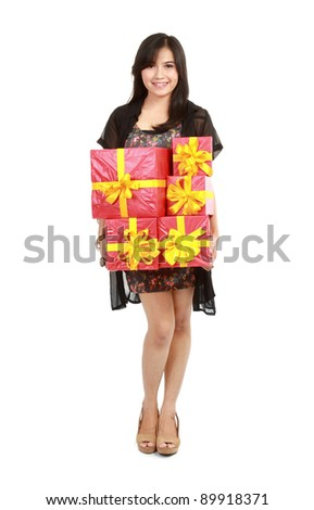 Beautiful girl carrying stack of gift box. Isolated. - stock photo
