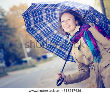 Beautiful girl catches a taxi on the road. - stock photo