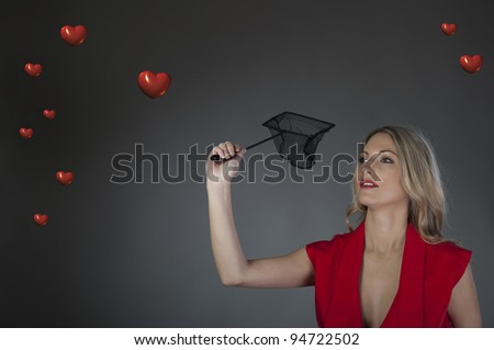 Beautiful girl catches heart - stock photo