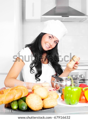 beautiful girl cooking in the kitchen at home