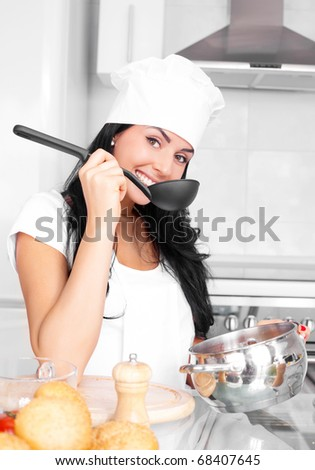 beautiful girl cooking in the kitchen at home - stock photo