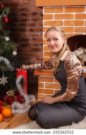 Beautiful girl decorating Christmas tree - stock photo