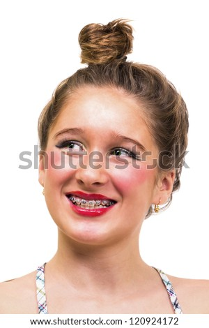 Beautiful girl delighted with her new dental brace - stock photo