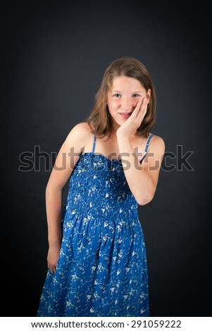 Beautiful girl doing different expressions in different sets of clothes: toothache - stock photo