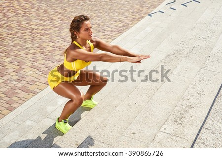 Beautiful girl doing squats - stock photo