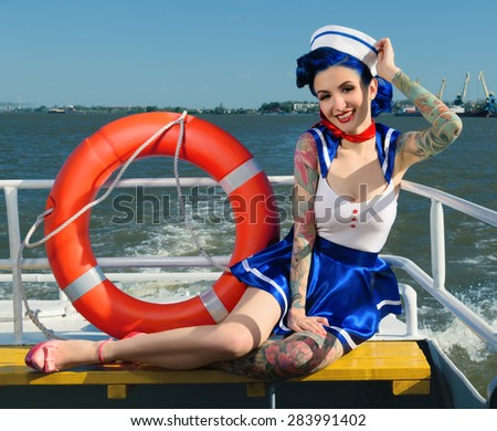 Beautiful girl dressed as sailors on merchant ships with tattoos, retro style - stock photo