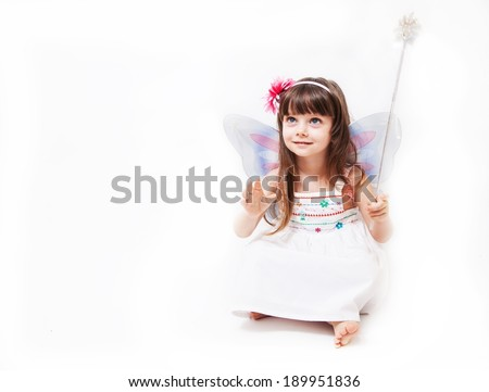 Beautiful girl dressed in fairy isolated on white background