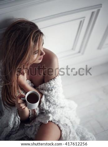 beautiful girl drinking coffee in the morning - stock photo